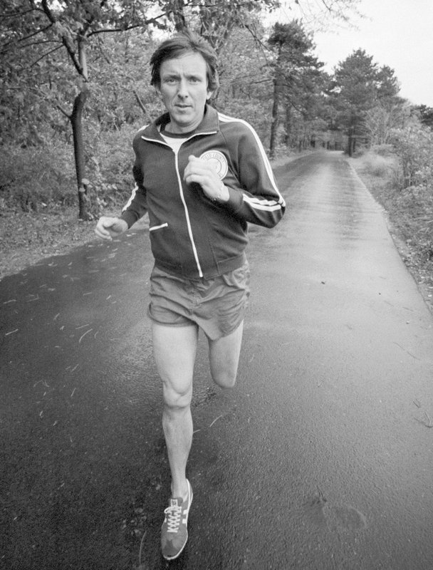 FILE - In this November 1977 file photo, marathoner Jim Fixx runs on a road near his home in Connecticut. (AP Photo/Jerry Mosey, File)