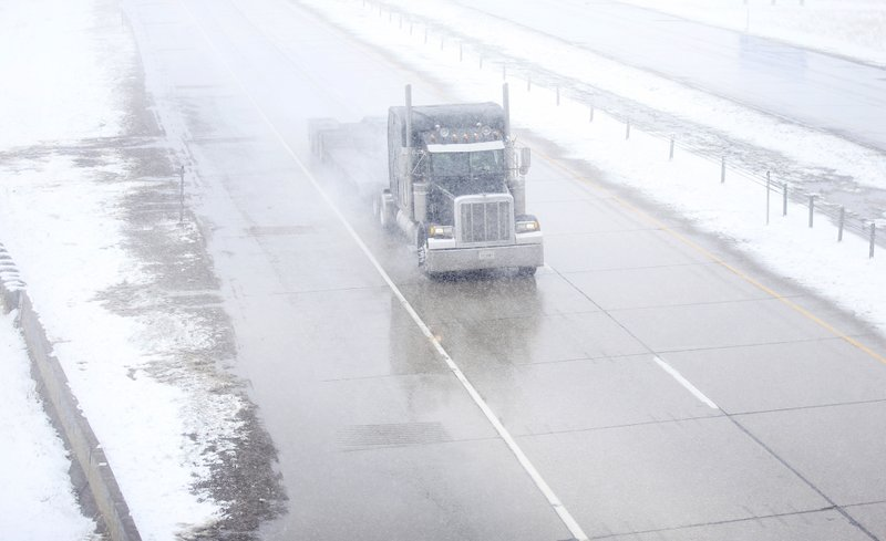 A truck travels east on Interstate 80 during a blizzard warning hitting southeast Wyoming and the Colorado Front Range on Wednesday, April 10, 2019, in Cheyenne. (Jacob Byk/The Wyoming Tribune Eagle via AP)