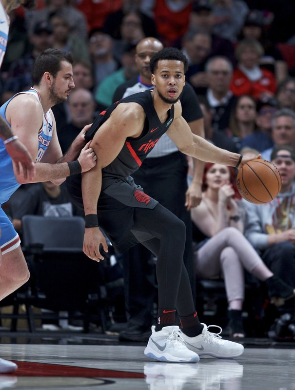 Portland Trail Blazers forward Skal Labissiere, right, posts up against Sacramento Kings forward Nemanja Bjelica during the first half of an NBA basketball game in Portland, Ore. (AP Photo/Craig Mitchelldyer)