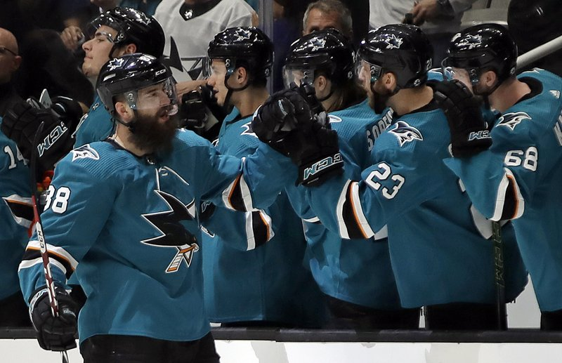 San Jose Sharks' Brent Burns, left, is congratulated for his goal against the Vegas Golden Knights during the second period of Game 1 of an NHL hockey first-round playoff series Wednesday, April 10, 2019, in San Jose, Calif. (AP Photo/Ben Margot)