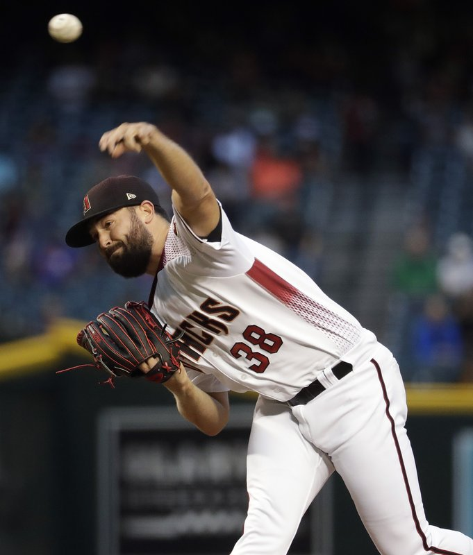 Arizona Diamondbacks Starting pitcher Robbie Ray throws to a Texas Rangers batter during the first inning of a baseball game Wednesday, April 10, 2019, in Phoenix. (AP Photo/Matt York)