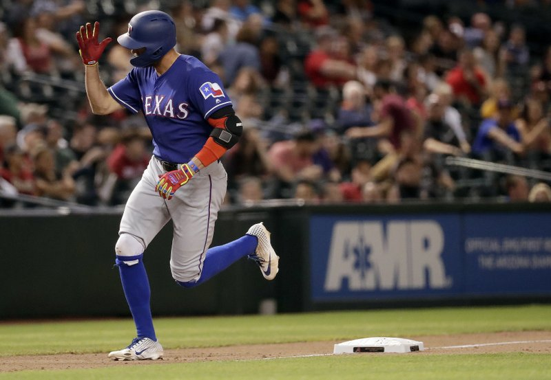 Texas Rangers' Hunter Pence runs the bases after hitting a solo home run against the Arizona Diamondbacks during the eighth inning of a baseball game, Wednesday, April 10, 2019, in Phoenix. (AP Photo/Matt York)