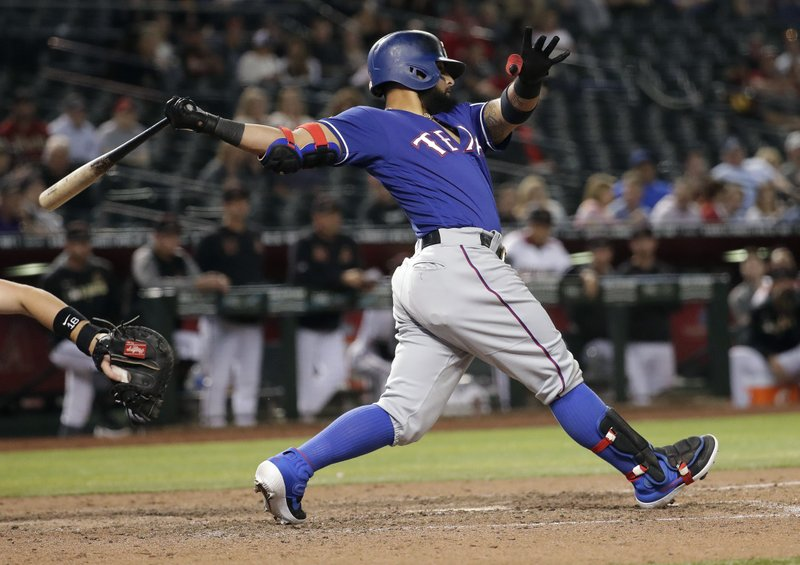 Texas Rangers' Rougned Odor follows through on an RBI base hit against the Arizona Diamondbacks during the eighth inning of a baseball game Wednesday, April 10, 2019, in Phoenix. (AP Photo/Matt York)
