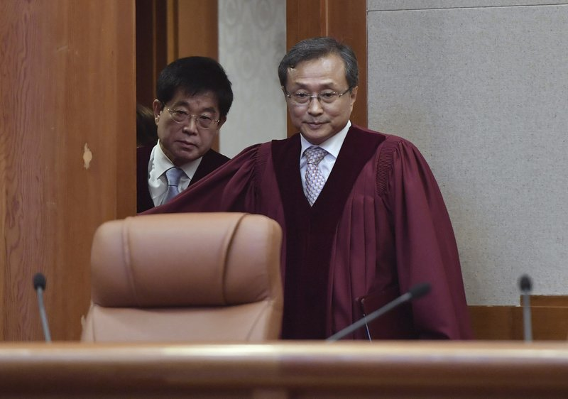South Korea's Constitutional Court chief judge Yoo Nam-seok, right, arrives for the ruling on decriminalization of abortion at the court in Seoul Thursday, April 11, 2019. (Jung Yeon-je /Pool Photo via AP)