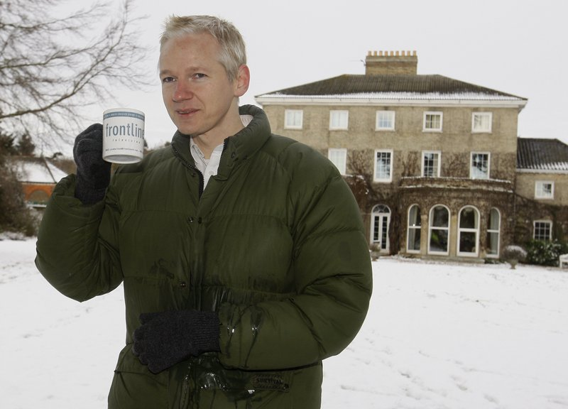 FILE - In this Friday, Dec. 17, 2010 file photo, Julian Assange head of WikiLeaks takes a drink during a press conference at the home of Frontline Club founding member Vaughan Smith, at Bungay, England. (AP Photo/Kirsty Wigglesworth, File)