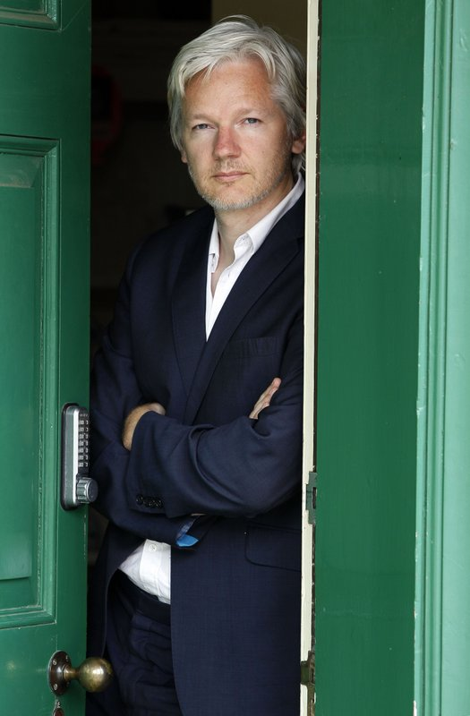 FILE - In this Wednesday, June 15, 2011 file photo, WikiLeaks founder Julian Assange is seen at the house where he is required to stay in, near Bungay, England. (AP Photo/Kirsty Wigglesworth, File)
