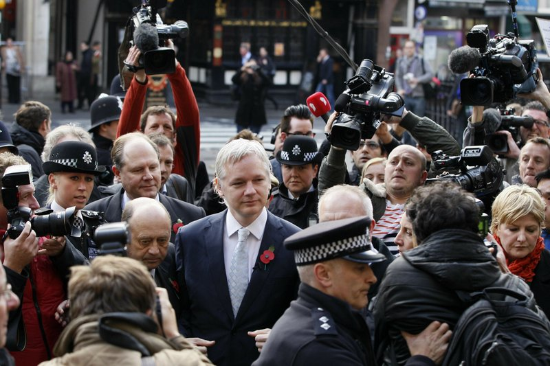 FILE _ In this Wednesday, Nov. 2, 2011 file photo, the founder of WikiLeaks Julian Assange, center, arrives for his extradition hearing at the High Court in London. (AP Photo/Kirsty Wigglesworth, File)