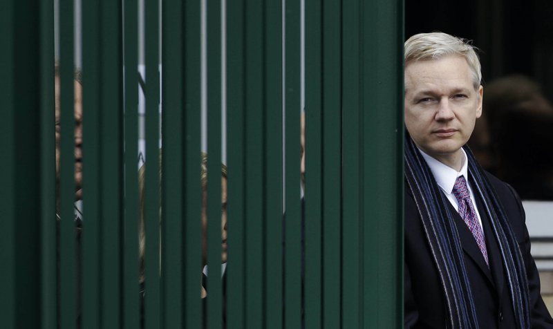 FILE  - In this Friday, Feb. 11, 2011 file photo, WikiLeaks founder Julian Assange leaves Belmarsh Magistrates' Court in London. (AP Photo/Matt Dunham, File)