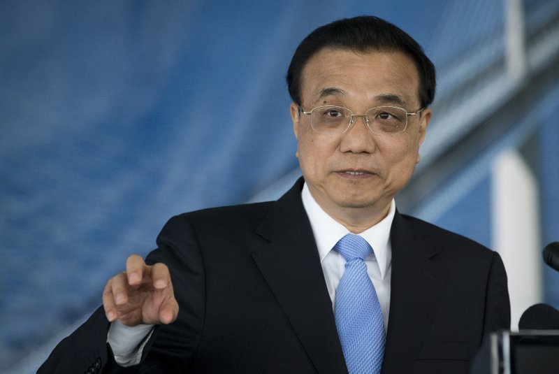 China's Premier Li Keqiang speaks during a ceremony at the construction site of a bridge built by a Chinese company and largely EU founded, in Brijesta, Southern Croatia, Thursday, April 11, 2019. (AP Photo/Darko Bandic)