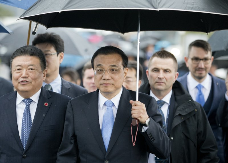 China's Premier Li Keqiang arrives at the construction site of a bridge built by a Chinese company and largely EU founded, in Brijesta, Southern Croatia, Thursday, April 11, 2019. (AP Photo/Darko Bandic)