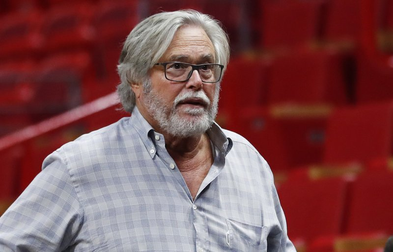 In this March 13, 2019 photo, Micky Arison, Miami Heat managing general partner and chairman of Carnival Cruise Line, walks courtside before the start of an NBA basketball game in Miami. (AP Photo/Wilfredo Lee)