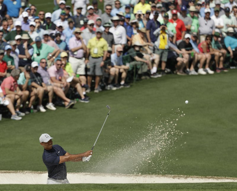 Tiger Woods hits from a bunker on the second hole during the first round for the Masters golf tournament Thursday, April 11, 2019, in Augusta, Ga. (AP Photo/Chris Carlson)