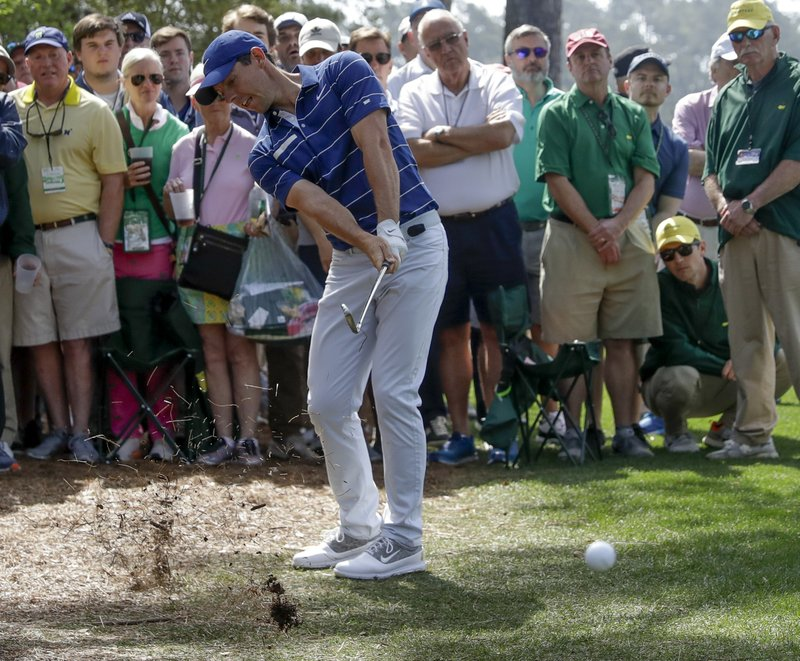 Rory McIlroy, of Northern Ireland, hits from the rough on the first hole during the first round for the Masters golf tournament Thursday, April 11, 2019, in Augusta, Ga. (AP Photo/Marcio Jose Sanchez)