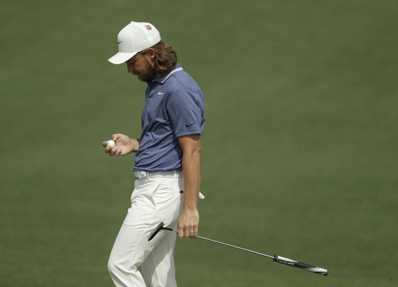 Tommy Fleetwood, of England, reacts after missing an eagle putt on the second hole during the first round for the Masters golf tournament Thursday, April 11, 2019, in Augusta, Ga. (AP Photo/Chris Carlson)