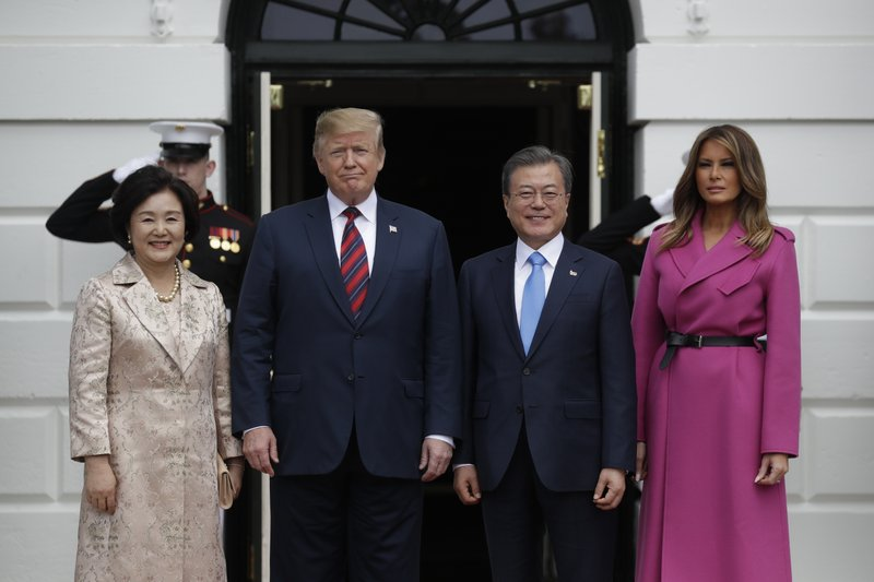 President Donald Trump and first lady Melania Trump greet South Korean President Moon Jae-In and his wife Kim Jung-Sook on the South Lawn of the White House, Thursday, April 11, 2019, in Washington. (AP Photo/Evan Vucci)