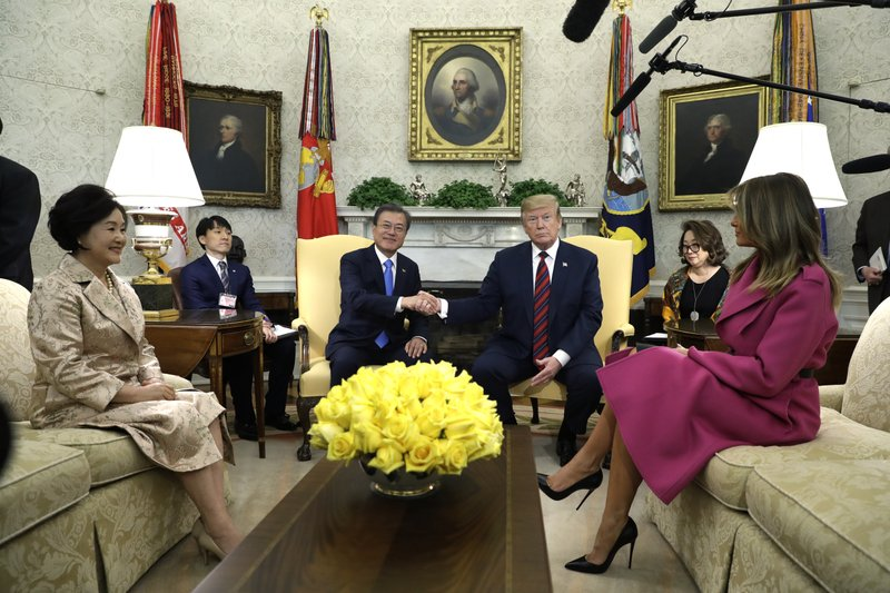 President Donald Trump and first lady Melania Trump meet with South Korean President Moon Jae-In and his wife Kim Jung-Sook in the Oval Office of the White House, Thursday, April 11, 2019, in Washington. (AP Photo/Evan Vucci)