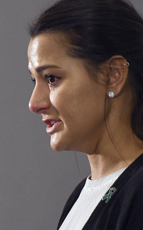 Bailey Kowalski cries as she speaks during a news conference in East Lansing, Mich., Thursday, April 11, 2019. (Matthew Dae Smith/Lansing State Journal via AP)