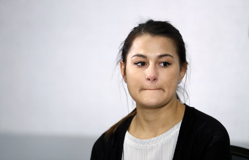 Bailey Kowalski appears during a news conference in East Lansing, Mich., Thursday, April 11, 2019. The 22-year-old Michigan State University student is speaking publicly a year after suing the school, alleging that three former men's basketball players raped her in 2015 and that she was discouraged by counseling center staff from reporting what happened.