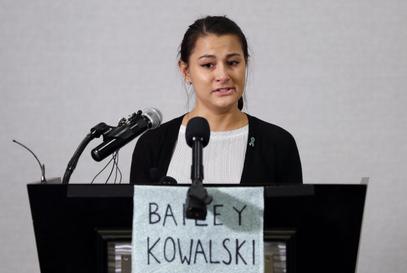 Bailey Kowalski speaks during a news conference in East Lansing, Mich., Thursday, April 11, 2019. The 22-year-old Michigan State University student is speaking publicly a year after suing the school, alleging that three former men's basketball players raped her in 2015 and that she was discouraged by counseling center staff from reporting what happened. (AP Photo/Paul Sancya)
