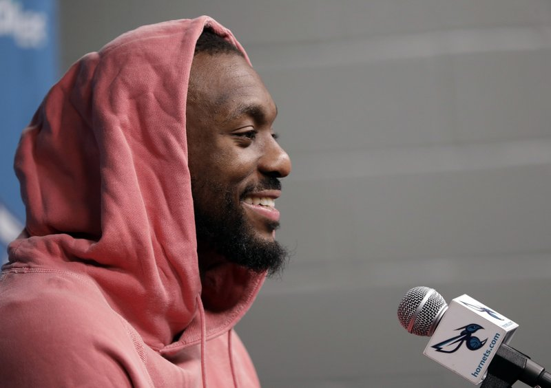 Charlotte Hornets' Kemba Walker smiles as he answers a question during end of season interviews for the NBA basketball team in Charlotte, N. (AP Photo/Chuck Burton)