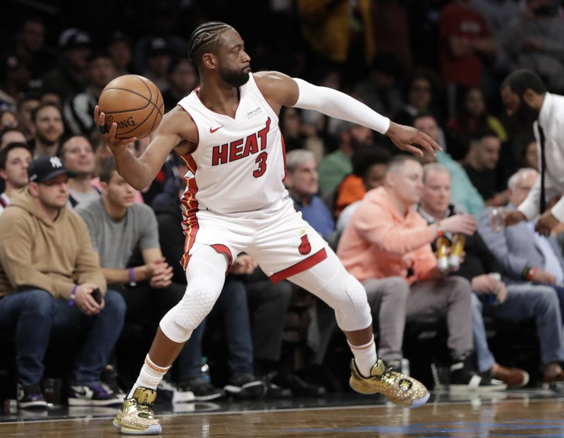 Miami Heat guard Dwyane Wade (3) prepares to pass the ball down court during the second half of the team's NBA basketball game against the Brooklyn Nets, Wednesday, April 10, 2019, in New York. (AP Photo/Kathy Willens)