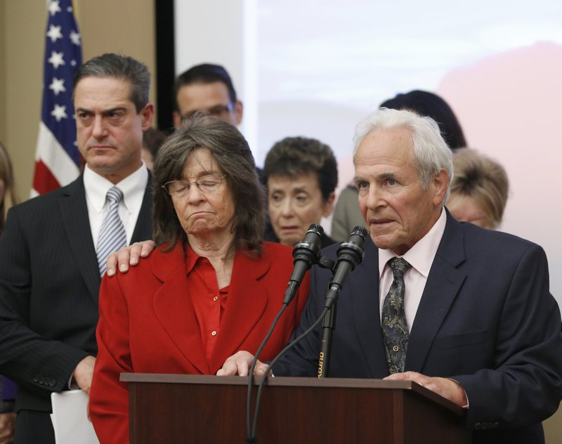 Steve Herr, right, accompanied by his wife, Raquel, second from left, the parents of murder victim Sam Herr, call on Gov. (AP Photo/Rich Pedroncelli)