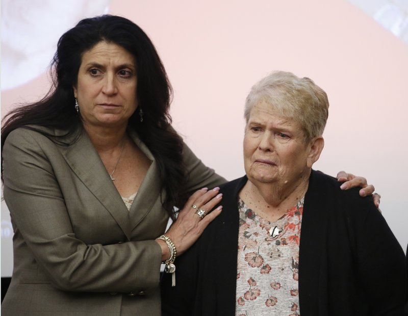 Jeri Oliver, right, whose son Danny Oliver was killed while on duty as a Sacramento County sheriff's deputy, is comforted by Nina Salarno Besselman, president of Crime Victims United of California after calling call on Gov. (AP Photo/Rich Pedroncelli)