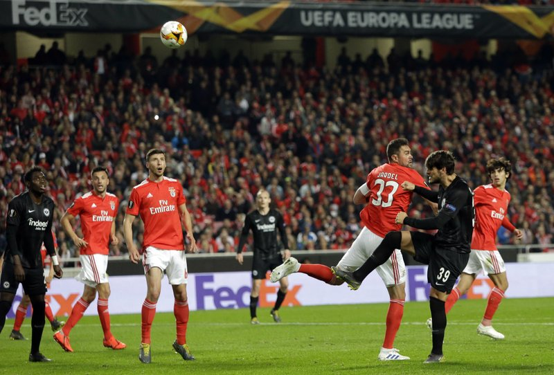 Frankfurt's Goncalo Paciencia, right, scores his side's second goal during the Europa League quarterfinals, first leg, soccer match between Benfica and Eintracht Frankfurt at the Luz stadium in Lisbon, Thursday, April 11, 2019. (AP Photo/Armando Franca)