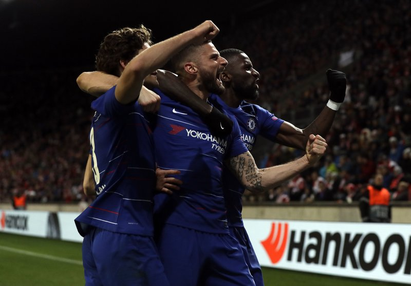Chelsea's Marcos Alonso, right, celebrates with teammates after scoring his side's first goal of the game during the UEFA Europa League quarterfinal soccer match between Slavia Prague and Chelsea at the Sinobo stadium in Prague, Czech Republic, Thursday, April 11, 2019. (AP Photo/Petr David Josek)