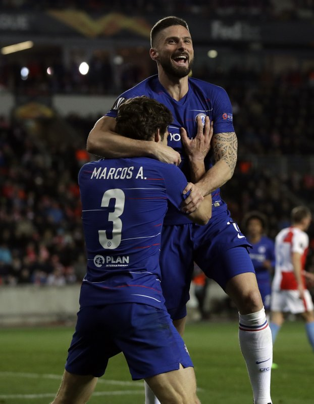 Chelsea's Olivier Giroud, right, celebrates after teammate Marcos Alonso, left, scored his side's first goal of the game during the UEFA Europa League quarterfinal soccer match between Slavia Prague and Chelsea at the Sinobo stadium in Prague, Czech Republic, Thursday, April 11, 2019. (AP Photo/Petr David Josek)