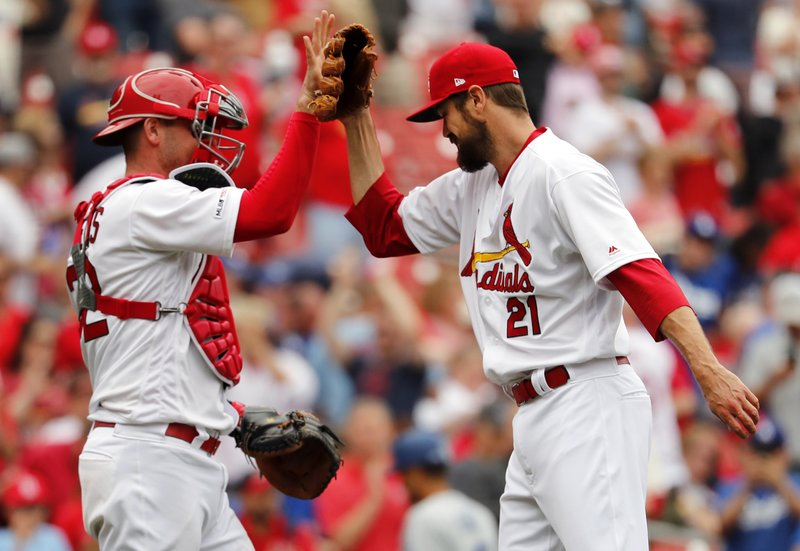 St. Louis Cardinals relief pitcher Andrew Miller, right, and catcher Matt Wieters celebrate an 11-7 victory over the Los Angeles Dodgers after a baseball game Thursday, April 11, 2019, in St. (AP Photo/Jeff Roberson)
