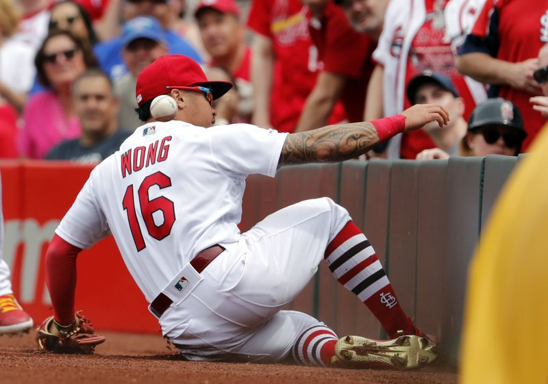 St. Louis Cardinals second baseman Kolten Wong slides but is unable to catch a foul ball by Los Angeles Dodgers' Joc Pederson during the fourth inning of a baseball game Thursday, April 11, 2019, in St. (AP Photo/Jeff Roberson)