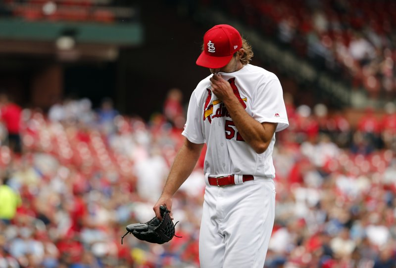 St. Louis Cardinals starting pitcher Michael Wacha walks off the field after being removed during the fourth inning of a baseball game against the Los Angeles Dodgers Thursday, April 11, 2019, in St. (AP Photo/Jeff Roberson)