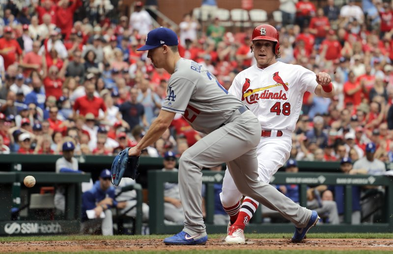 St. Louis Cardinals' Harrison Bader (48) scores on a wild pitch by Los Angeles Dodgers starting pitcher Walker Buehler as Buehler covers home during the second inning of a baseball game Thursday, April 11, 2019, in St. (AP Photo/Jeff Roberson)