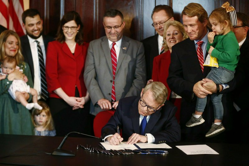 Gov. Mike DeWine speaks before signing a bill imposing one of the nation's toughest abortion restrictions, Thursday, April 11, 2019 in Columbus, Ohio. (Fred Squillante/The Columbus Dispatch via AP)