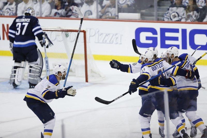 St. Louis Blues celebrate Tyler Bozak's goal against the Winnipeg Jets during the third period of Game 1 of an NHL hockey first-round playoff series Wednesday, April 10, 2019, in Winnipeg, Manitoba. (John Woods/The Canadian Press via AP)