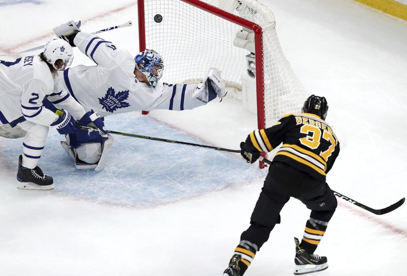 Boston Bruins center Patrice Bergeron (37) beats Toronto Maple Leafs goaltender Frederik Andersen for a goal during the first period of an Game 1 of an NHL hockey first-round playoff series Thursday, April 11, 2019, in Boston. (AP Photo/Charles Krupa)