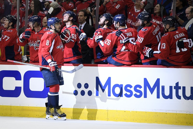 Washington Capitals left wing Alex Ovechkin (8), of Russia, celebrates his goal with the bench during the first period of Game 1 of an NHL hockey first-round playoff series against the Carolina Hurricanes, Thursday, April 11, 2019, in Washington. (AP Photo/Nick Wass)