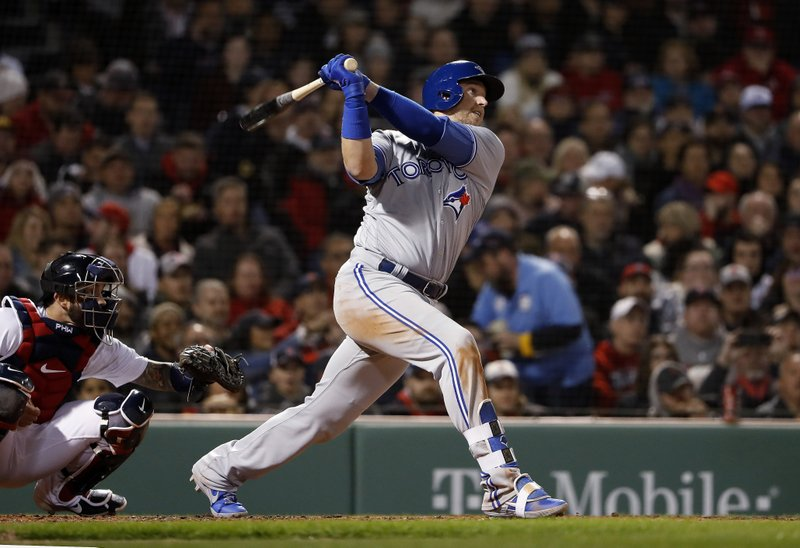 Toronto Blue Jays' Justin Smoak watches his three-run home run against the Boston Red Sox during the third inning of a baseball game Thursday, April 11, 2019, at Fenway Park in Boston. (AP Photo/Winslow Townson)
