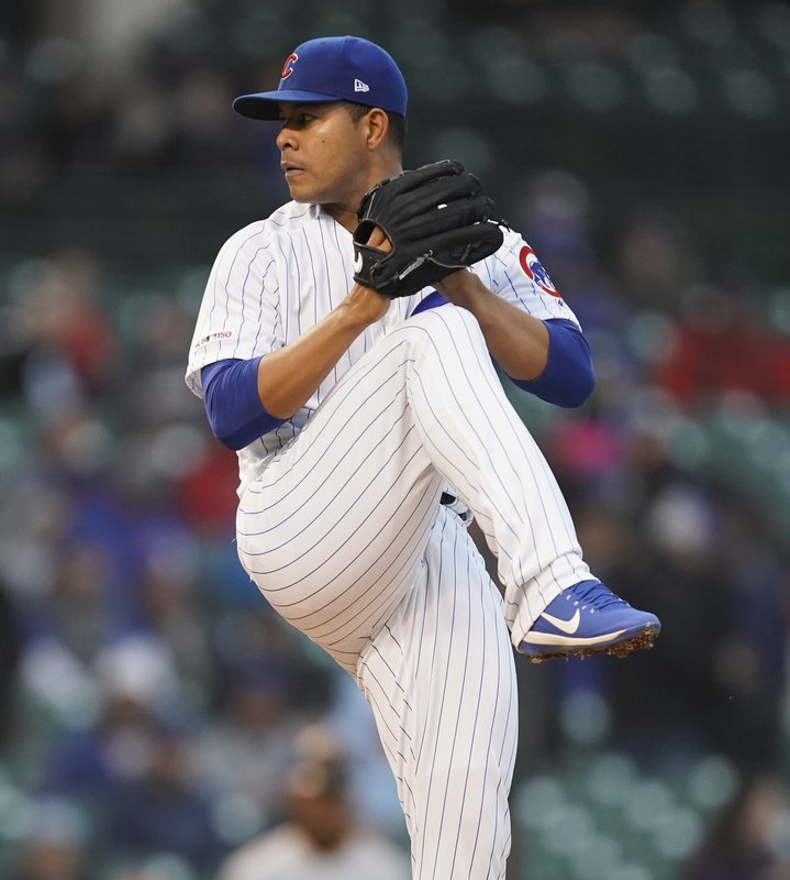 Chicago Cubs starting pitcher Jose Quintana winds up during the first inning of the team's baseball game against the Pittsburgh Pirates in Chicago, Thursday, April 11, 2019. (AP Photo/Nuccio DiNuzzo)