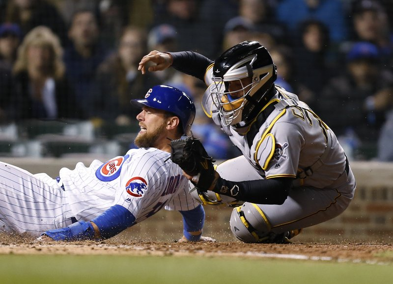 Chicago Cubs' Ben Zobrist is tagged out at home by Pittsburgh Pirates catcher Francisco Cervelli during the sixth inning of a baseball game in Chicago, Thursday, April 11, 2019. (AP Photo/Nuccio DiNuzzo)