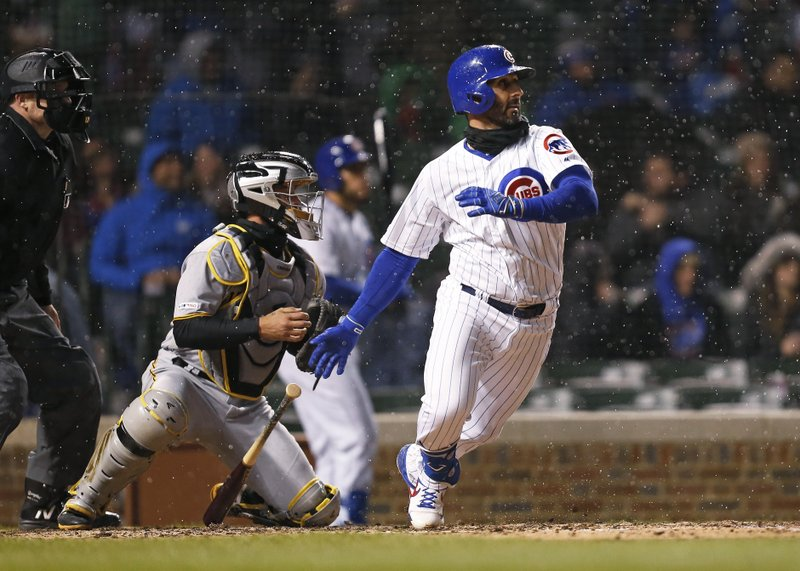 Chicago Cubs' Daniel Descalso watches his RBI single during the seventh inning of a baseball game against the Pittsburgh Pirates in Chicago, Thursday, April 11, 2019. (AP Photo/Nuccio DiNuzzo)