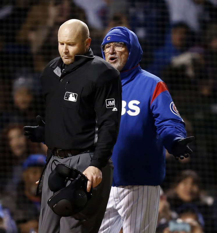 Chicago Cubs manager Joe Maddon, right, talks to home plate umpire Mike Estabrook after being ejected during the fifth inning of the team's baseball game against the Pittsburgh Pirates in Chicago, Thursday, April 11, 2019. (AP Photo/Nuccio DiNuzzo)