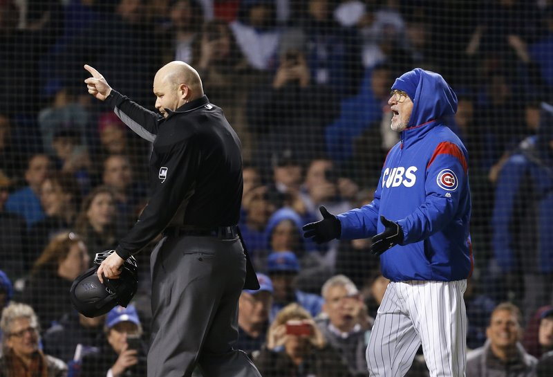 Chicago Cubs manager Joe Maddon, right, is ejected by home plate umpire Mike Estabrook during the fifth inning of the team's baseball game against the Pittsburgh Pirates in Chicago, Thursday, April 11, 2019. (AP Photo/Nuccio DiNuzzo)