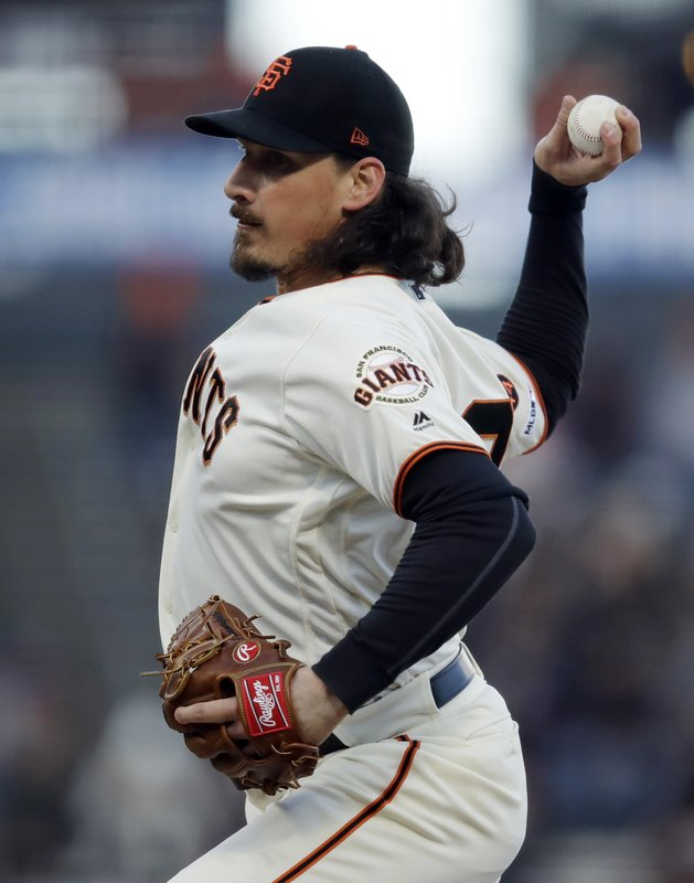 San Francisco Giants pitcher Jeff Samardzija works against the Colorado Rockies during the first inning of a baseball game Thursday, April 11, 2019, in San Francisco. (AP Photo/Ben Margot)
