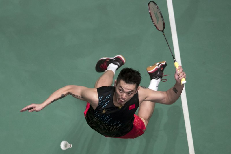 In this April 7, 2019, photo, China's Lin Dan returns a shot during Men's single final match against China's Chen Long at the Malaysia Badminton Open in Kuala Lumpur, Malaysia. (AP Photo/Vincent Thian)