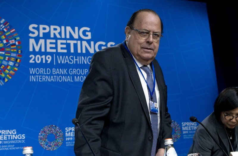 G-24 Chair and Governor of the Central Reserve Bank of Peru Julio Velarde arrives at a news conference after a meeting of the G-24 at the World Bank/IMF Spring Meetings in Washington, Thursday, April 11, 2019. (AP Photo/Jose Luis Magana)