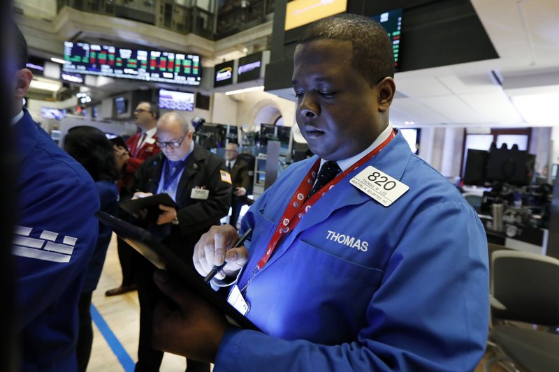 Trader Thomas Lee works on the floor of the New York Stock Exchange, Thursday, April 11, 2019. U.S. stocks moved slightly higher in morning trading Thursday as investors prepare for the latest round of corporate earnings. (AP Photo/Richard Drew)
