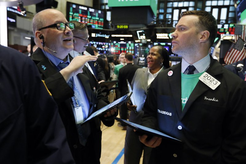 Traders Jeffrey Vazquez, left, and Frank Masiello confer on the floor of the New York Stock Exchange, Thursday, April 11, 2019. (AP Photo/Richard Drew)