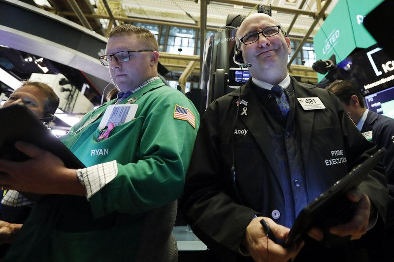 Traders Ryan Falvey, left, and Andrew Silverman work on the floor of the New York Stock Exchange, Thursday, April 11, 2019. (AP Photo/Richard Drew)